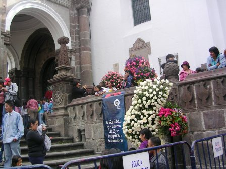 People coming and going from a church in Quito during the Fiestas of Quito