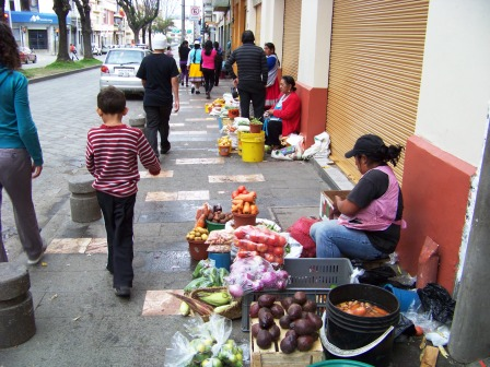 Women selling along the sidewalk in Cuenca