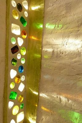 recycled glass bottle windows in stariwell