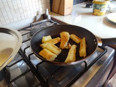 Making fried yuca.