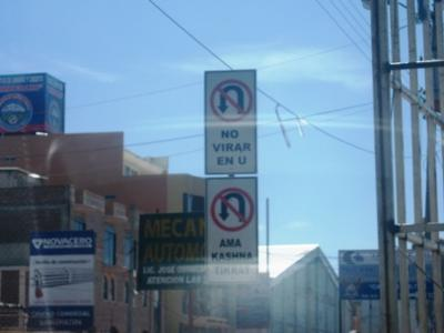 No U Turn sign in Spanish and Quichua