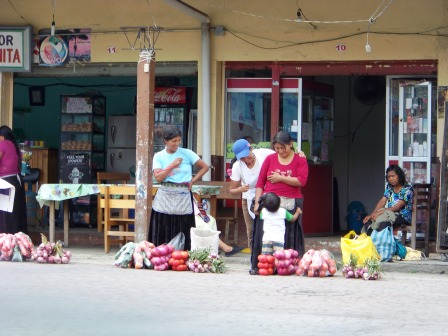 Women selling in front of the terminal in Tena