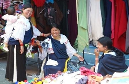 Quichua women selling goods from Otavalo, Ecuador.